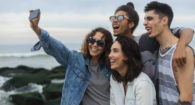 Friends posing for a selfie on the beach